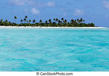 View from the sea of Maina Island in Aitutaki Lagoon Cook Islands.