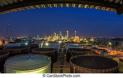 Landscape of oil refinery industry with oil storage tank and...
