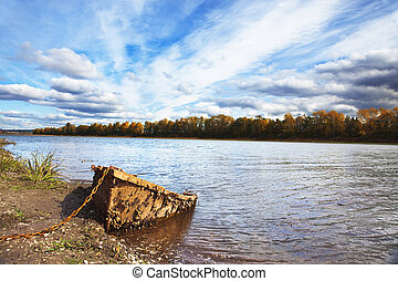 landscape of old boat on the river bank