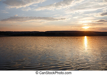 Landscape of pure spring sunset over lake.