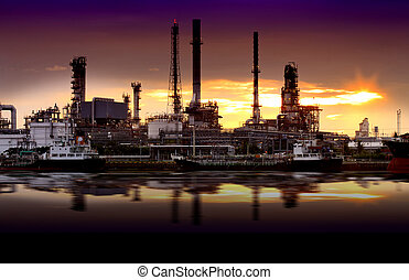 Landscape of river and oil refinery factory between sun rise...