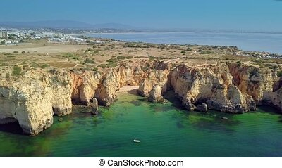 Landscape of rocky coastline and city - Aerial shot taken...