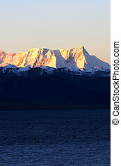 Landscape of snow-capped mountains at lakeside