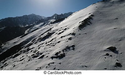 Landscape of snow covered mountain landscape. - Bright sun...
