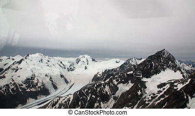 Landscape of snow mountain panorama view from helicopter window in New Zealand.