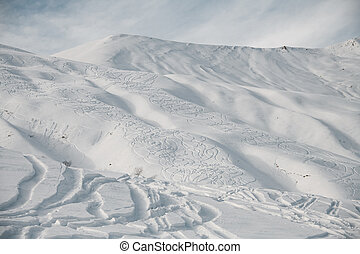 Landscape of snowy slope of the mountain