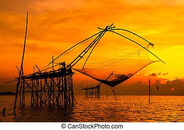 Landscape of square dip net or Yo(Thai language)made of bamboo in morning at Ban Pak Pra -Talay Noi Lake, Phatthalung, Thailand