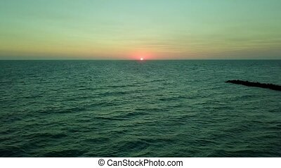 Landscape of sunrise in ocean - View of blue water ocean...