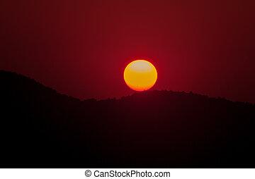 Landscape of sunrise over mountain.