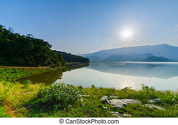 Landscape of sunset with lake and mountain