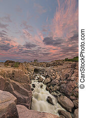 Landscape of the Augrabies Waterfall at sunset and pink clouds