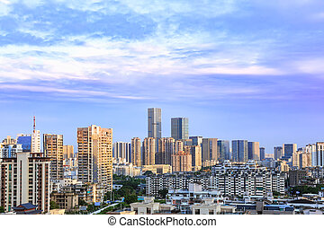 Landscape of the city skyline at dusk, in Aerial view with skyscraper, modern office building and blue sky background in Fuzhou, Fujian, China.