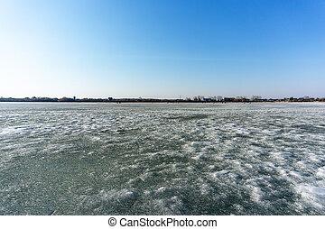 landscape of the frozen river winter lake.