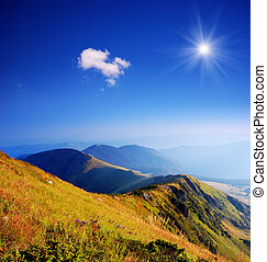 Landscape of the mountain range - Sun over the ridge. Summer...