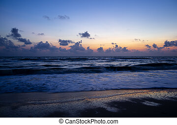 Landscape of the sea on the beach before sunrise.