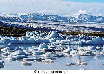 Landscape of Vatnajokull glassier viewed from Fjallsarlon glacier lake in Southern Iceland