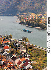 Landscape of Wachau valley, Spitz village with boats on Danube river in Austria.