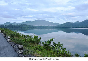 landscape of water reservoir lake with mountain background