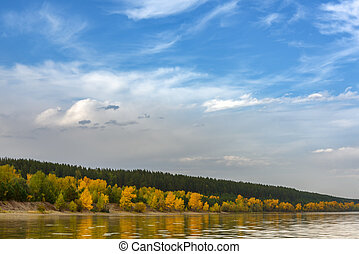 Landscape on the river, sky with clouds
