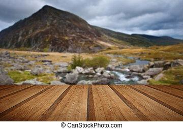 Landscape over waterfall towards Pen-yr-Ole-Wen mountain in...