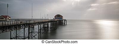 Landscape panorama long exposure peaceful image of Mumbles pier