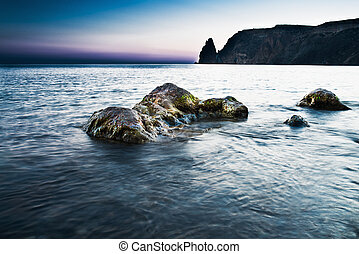 rocks in the sea in sunset
