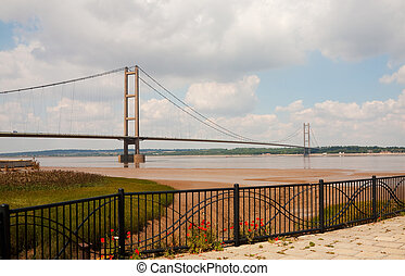Landscape photo of the Humber bridge UK taken from the south bank of the river Humber