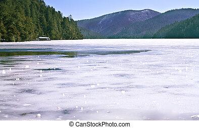 Landscape photo of Treking route along beautiful ice lake in Shangri-La Mountain area in China