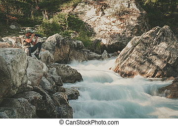 Landscape Photographer Taking Pictures of Scenic Waterfall