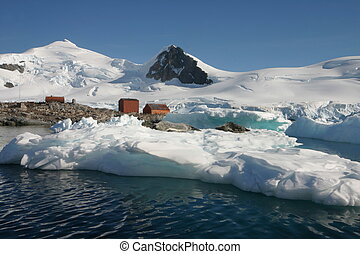 Landscape, Sea Leopards  and some old houses in Antarctica on a cloudless day