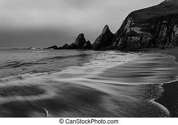 Landscape seascape of jagged and rugged rocks on coastline ...