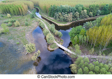 Aerial image of beautiful river and forest landscape shot with drone in spring
