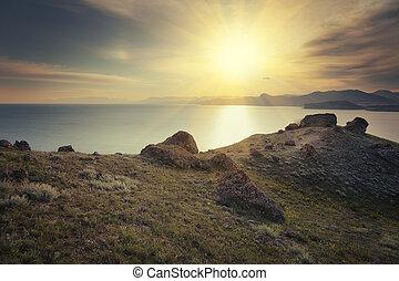 Sun over the seacoast at sunset