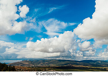 landscape sunny skies with clouds mountain forest