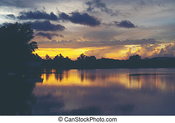 landscape sunset over the tropical lake in Thailand