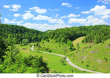 Typical country road and landscape on the Swabian Alb, Baden-Wuerttemberg, Germany