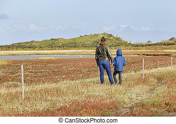 Family crossing Nature reserve De Slufter on the Waddenisland Texel, North Holland, Netherlands