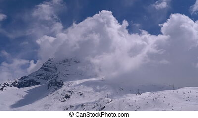 Landscape view of Alpine Mountain Snowy Peak in the Clouds....