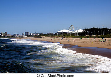 Landscape View of Beach Against City Skyline - View of Blue...