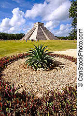Landscape view of famous Chichen Itza pyramid with cactus in...