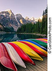 Landscape view of Moraine lake with colorful boats, Rocky Mountains