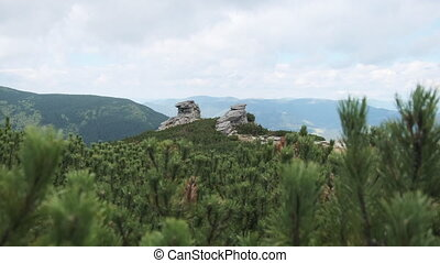 Landscape view of Mountain Valley with Large Vertical Stones Standing on a Hill