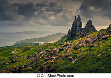 Landscape view of Old Man of Storr rock formation, dramatic clouds, Scotland