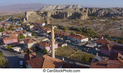 Landscape view of old town Goreme at Cappadocia, Turkey. Panorama of old Cappadocian city on a sunny day.
