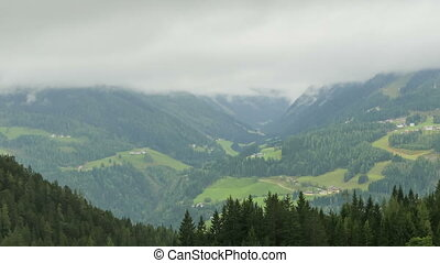 Landscape view of the Clouds Moving over the Hills of the Alpine Mountains. Timelapse