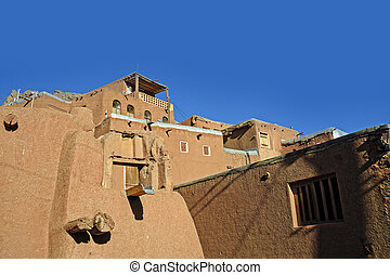 landscape view traditional red clay houses at desert mountain village of Abyaneh county of Natanz  Isfahan in Iran
