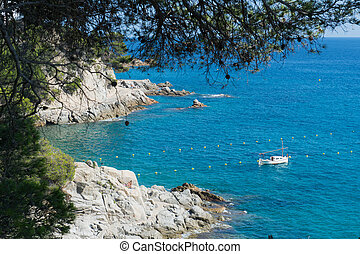 landscape coast Costa Brava with sea and fishing boat