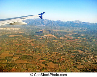 Landscape while flying -aerial view - airplane wing