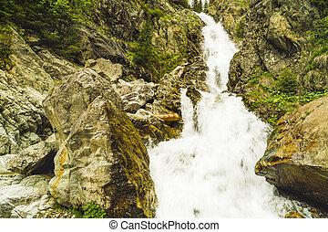Landscape with a big waterfall in the mountains