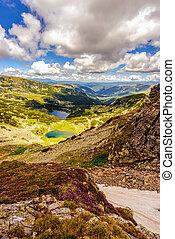 Landscape with a glacial lake in the highlands of Fagaras mounta